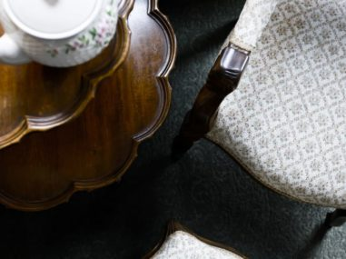 downward view of chair and table with teapot