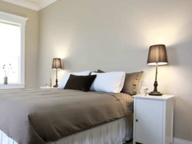 2 brown lamps and brown bedspread