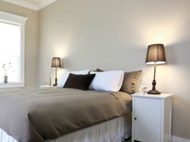 room with two brown lamps and brown bedspread