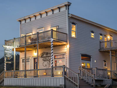 building brightly lit with interior and exterior lights
